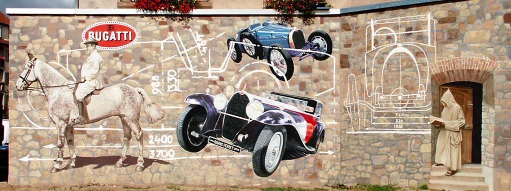 Hommage à Bugatti à Molsheim. Vue d'ensemble de la fresque de Roland Perret. illusions-murales.com