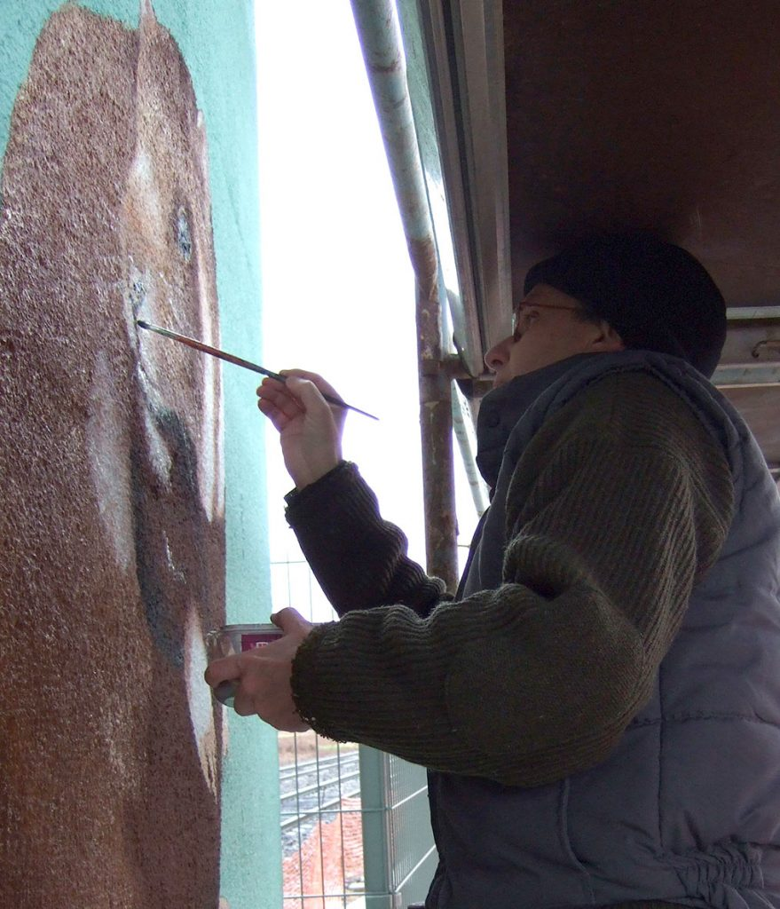 Le peintre sous le pont de la gare de Duppigheim. Fresque de Roland Perret. illusions-murales.com