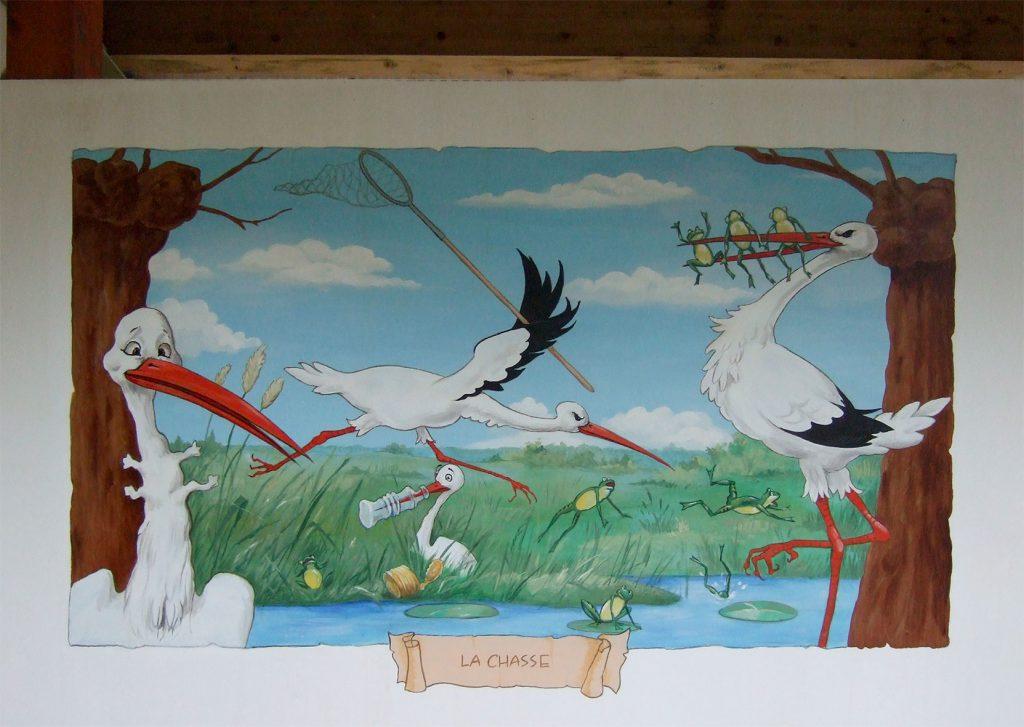 La chasse des cigognes. Décors à Cigoland. Fresques de Roland Perret  illusions-murales.com